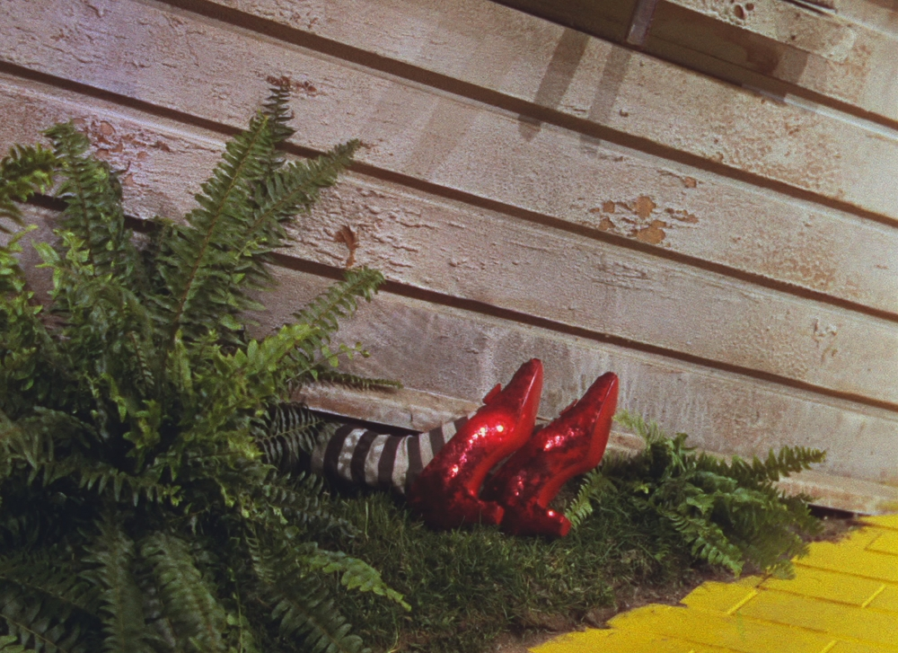 wizard-of-oz-1939-003-ruby-slippers-under-house-00n-ogkWizard Of Oz Ruby Slippers Under House